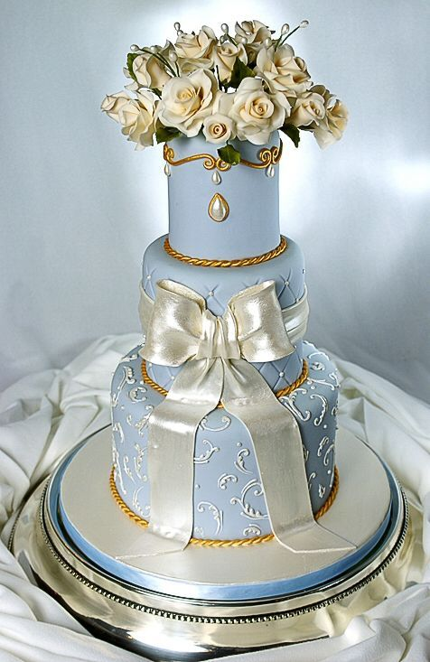 "Cake show entry - This was my entry for the Austin cake show. It's made with 4"", 6"", 9"" round dummies that are 5"" high. The flowers and bow are gumpaste and the piping is done with royals icing. Thanks for looking."