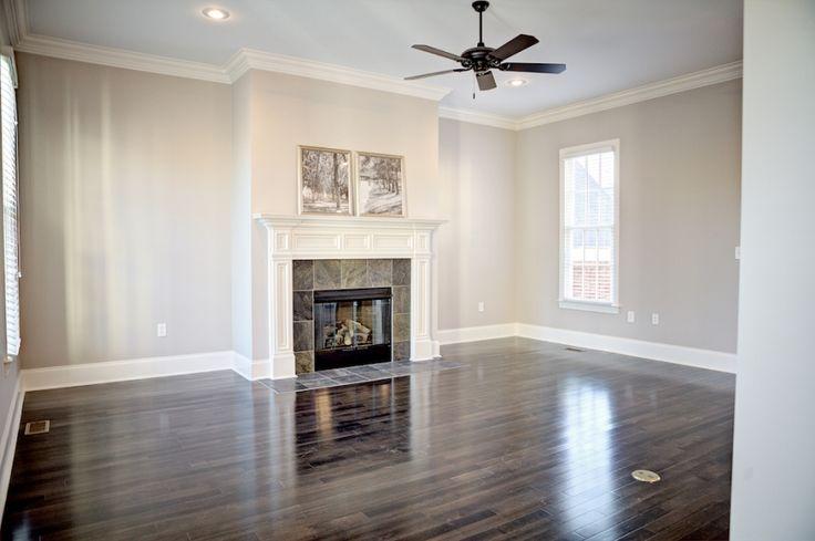 Love the dark flooring and tone on tone walls #livingroom