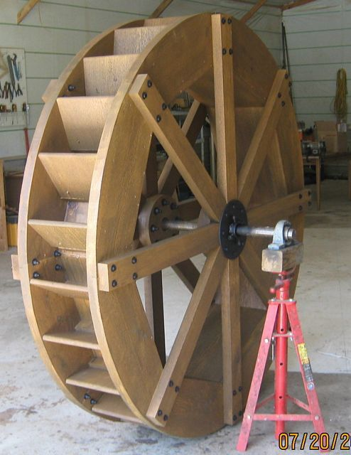6 foot rustic style water wheel with black bolt construction. This is a very solid wheel design for a heavy rustic look with 2 piece elbow b...