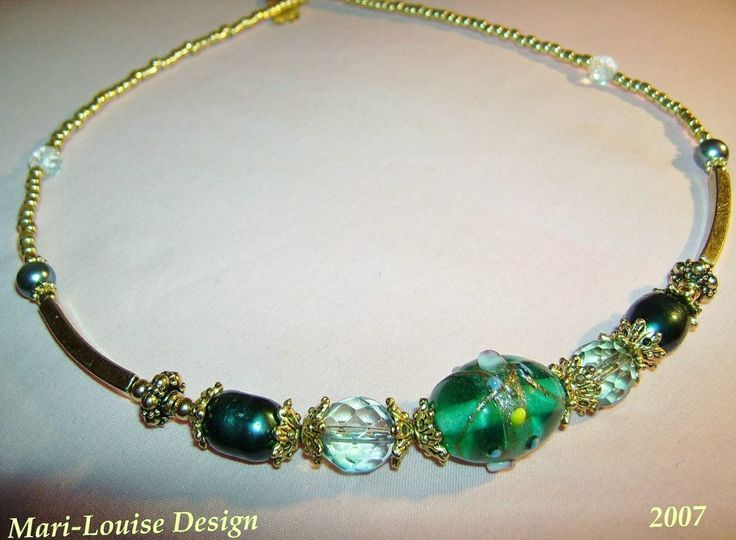 Necklace of Lampwork, Swarovski and sweetwaterpearls