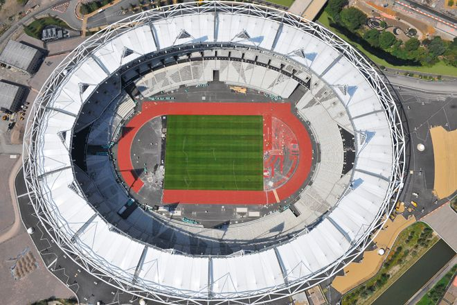 An aerial photograph of the Olympic Stadium in Stratford, East London
