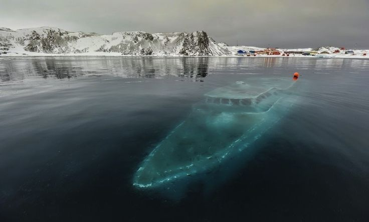 Sunken yacht in Antarctica | The 33 Most Beautiful Abandoned Places In TheWorld