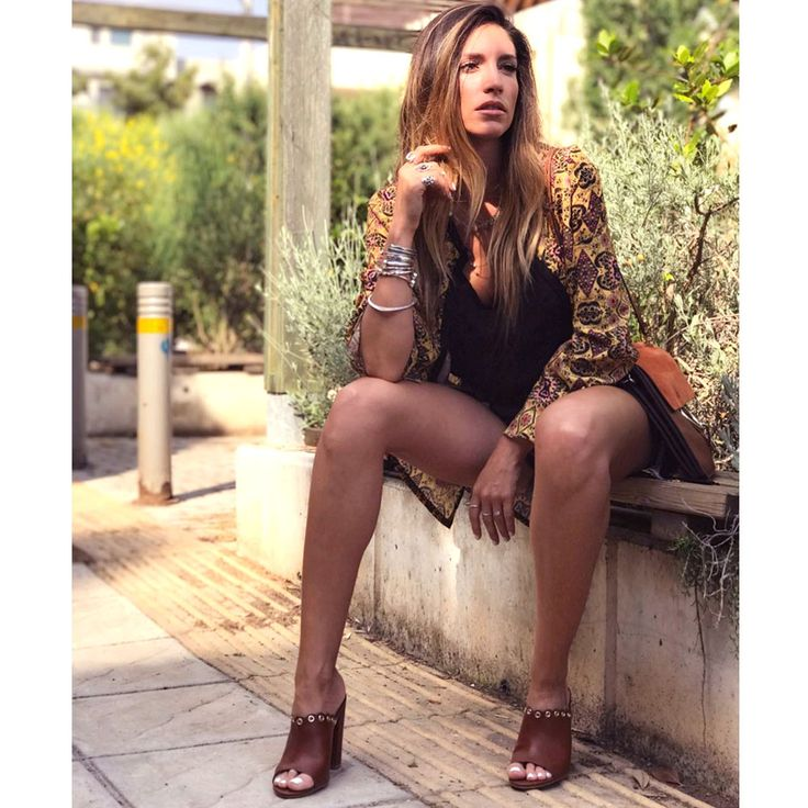 Actress Athina Oikonomakou highlighted her boho look with #MIGATO ES3216 tobacco mules!  Shop link ► bit.ly/ES3216-L23en