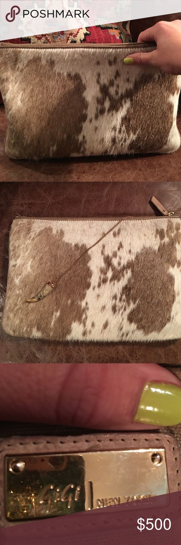 GiGi Authentic Cowhide Clutch/iPad case Fits the large iPad Pro!  I also have used as a clutch.  Real cowhide.  I get so many compliments on it and hate to part with it.  Paid $1200.00.  There are a few make-up stains in the lining. GiGi New York Accessories Tablet Cases