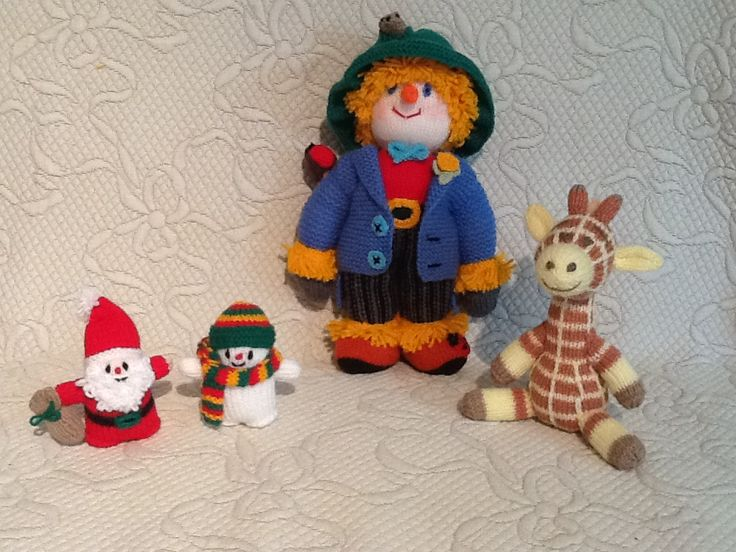 I've been busy knitting.  Scarecrow and Father Christmas from a Jean Greenhowe book, snowman - my adaptation from Jean's pattern and the giraffe is from the very clever Alan Dart.