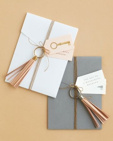 Welcome out-of-towners warmly with a celebration itinerary embellished with a keepsake leather tassel key chain