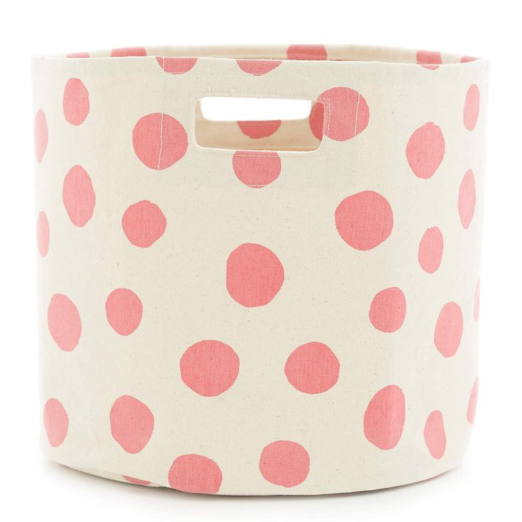 Make a storage style statement with this durable woven cotton bin. Featuring a coral polka dot print that pops against a white background, this storage bin is durable enough to haul bed and bath linens, clothing and accessories, and even toys, yet pretty enough to display in your bedroom, bathroom, or kids rooms. Part of our exclusive collaboration with Pehr Designs, Mina coordinates with any of our coral C3 bedding and bath accessories, including shower curtains, bath mats, towels, and…