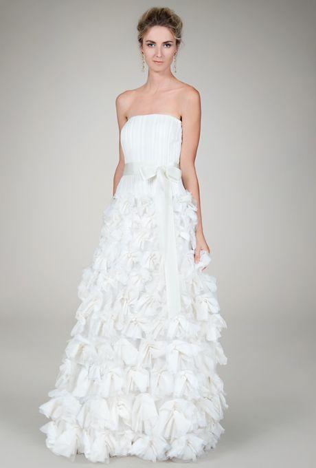 Brides.com: . Tadashi Shoji. Ivory hand-cut flower gown  See more Tadashi Shoji wedding dresses