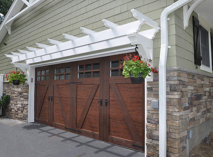 Carriage style garage doors with trellis cultured stone for Wood veneer garage doors
