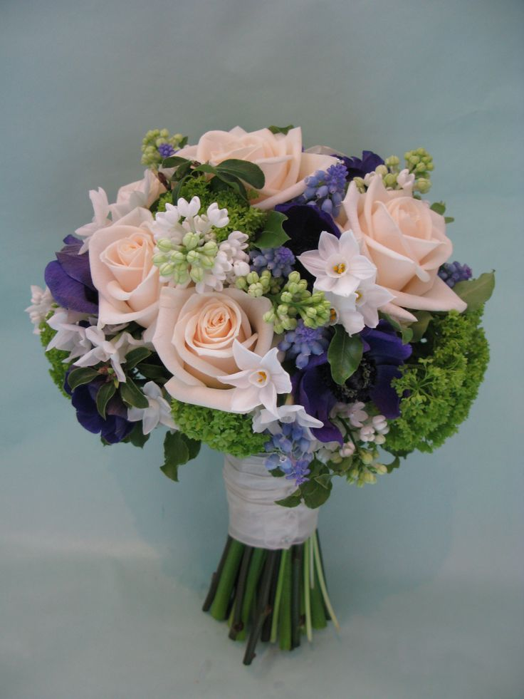 A cream and blue bridal bouquet, of Roses, Anemones, Grape Hyacinths, Lilac, Paperwhites and Viburnum.