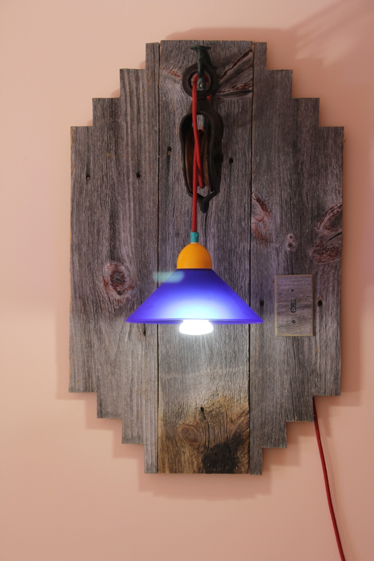 In remodeling my scrapbook/hobby room, I designed a Southwestern style piece. My husband cut it out from Barn Board. We bought a barn pulley and antique bracket at an antique store, a cobalt blue glass lampshade at another antique store, cotton red braided up to code lamp wire from Sundial Wire and my husband cut a switch plate out from the barn board to which we put a nightlight switch to find in the dark. Love it!