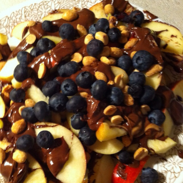 My version of apple nachos  Apple slices peanut butter chocolate chips peanuts and blueberries yummy: Recipe, Slices Peanut, Peanut Butter, Chips Peanut