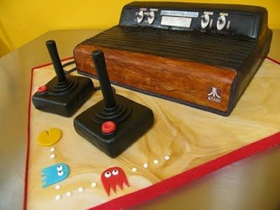 My brother has requested an Atari cake.  Something like this might be a little out of my league...