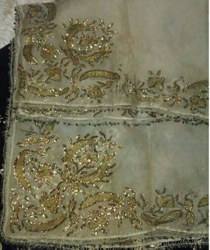 Mid-sized 'çevre' (square kerchief; a decorative accessory for interiors, but also often used in the parade costume of the 'Efe'; it then partly covers his weapons ). Circa 1900. Embroidered with 'two-sided goldwork' combined with the 'tel kırma' technique (geometrical motives obtained by sticking narrow metallic strips - often silver - through the fabric and folding them). All motifs are identical on both sides of the fabric.