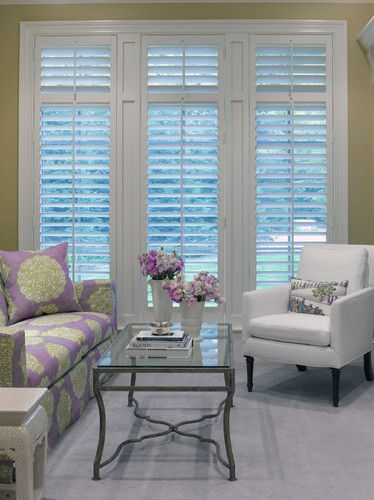 Tall plantation shutters with open louvers allow lots of light.