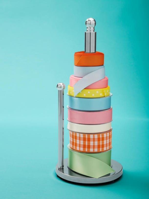 Keep gift wrap ribbon tidy and wrapping efficient by looping spools over a paper towel holder.