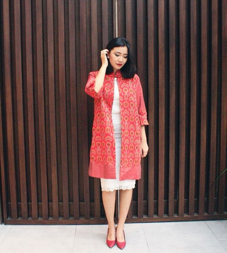 """Chic long red coat from #IKATIndonesia Chinese New Year Collection. Available at IKAT Indonesia Boutique (Jl. Dempo I no. 59)."""