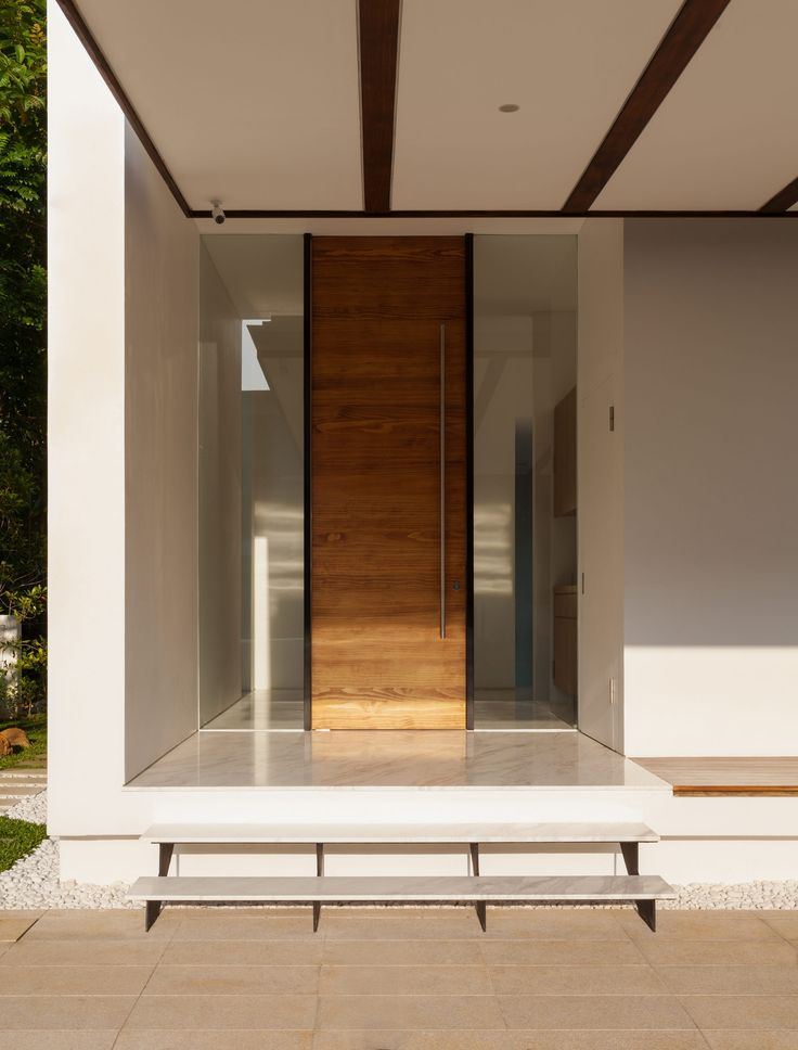 Front door-could possibly go wood front door (same wood as entranceway)flanked by glass; like the simple pull too