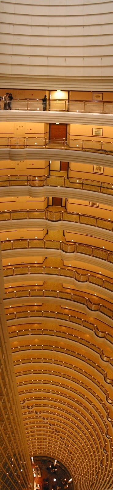 Grand Hyatt Hotel, Jin Mao Tower, Shanghai. Stories, balconies, and floors, scaling high in a giant building.