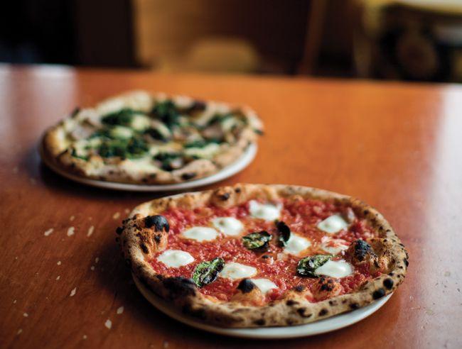 Il Pizzaiolo's Salsiccia e Rapini pizza (fresh mozzarella, sausage, rapini, pecorino cheese, olive oil) + the Classic Margherita DOC pizza (San Marzano tomato sauce, mozzarella di bufala, Parmigiano-Reggiano cheese, basil, olive oil).
