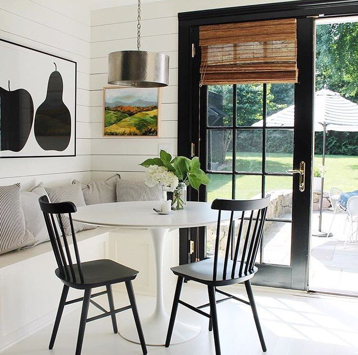 Kitchen dining nook with black French doors