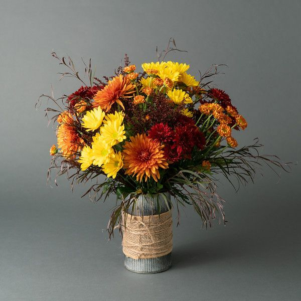 What Says Fall More Than Mums Galvanzed Tin Vase Wrapped In Burlap Overflowing With Fall M Fall Flower Arrangements Same Day Flower Delivery Flower Delivery
