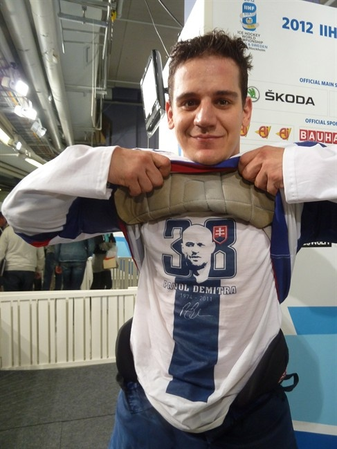 Slovak player Branko Radivojevic lifts his equipment to show his shirt in the memory of Pavol Demitra after a 3-1 win over the Czech Republic in the semifinals in Helsinki, Finland, Saturday, May 19, 2012.