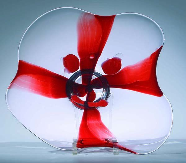 "Lubomir Blecha, glass disc from serie ""Face of glass"", 1957, D: 40,0 cm, glassworks Skrdlovice. In the next stage, the space of faces was consistently divided into four segments, by this transformation took on human form of the cross"