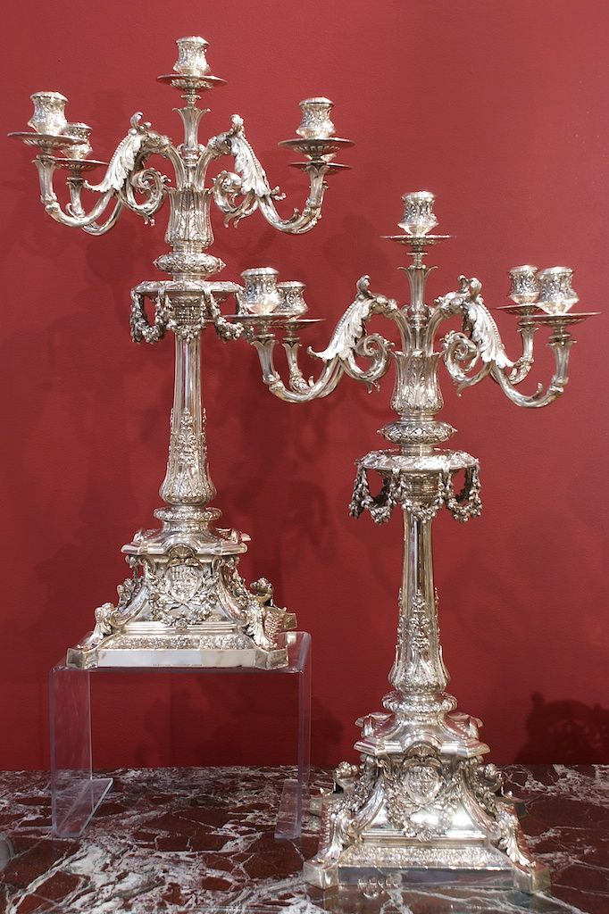 A pair of Victorian silver five light candelabra. Designed by Charles Philip Slocombe (1832-1895)  Made by Barnard  Bros, retailed by Hancock, London 1865. Charles Philip Slocombe trained at the South Kensington Art school and was later Professor there c1881. Slocombe is mentioned in the Barnard accounting lists of suppliers from 1857 when he was paid £16 1s 8d until 1872. He attended the School of Design at Somerset House London