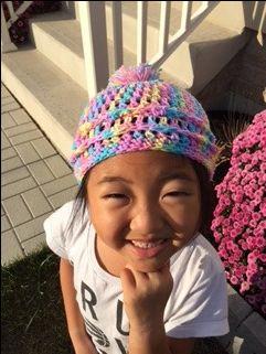 Chloe wearing a winter hat.
