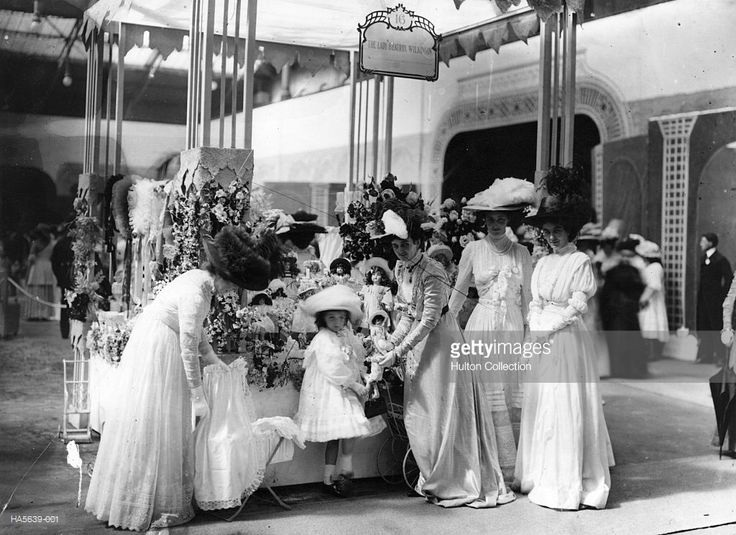 Lady Beatrix Wilson and her daughter run stall 16 at a midsummer fete in aid of Great Ormond Street Children's Hospital, held at Olympia, London.