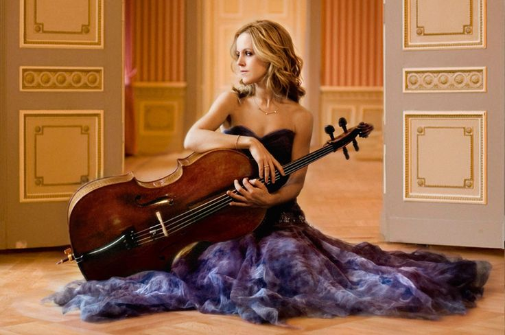 Musician with cello, flowing dress