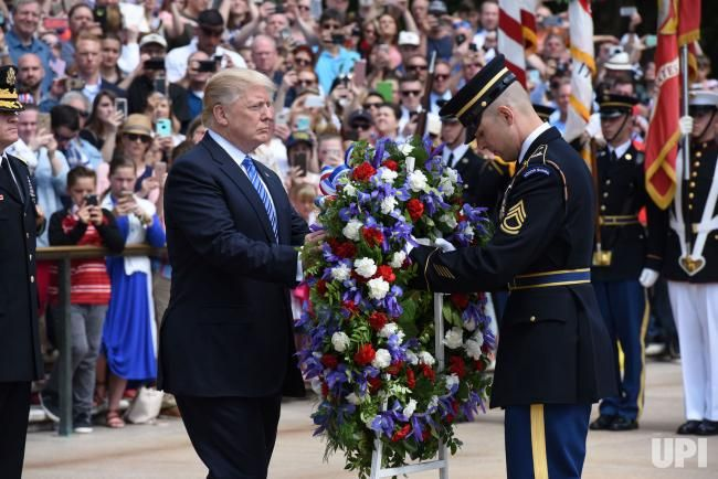 President Donald Trump participates in a wreath-laying ceremony at the Tomb of the Unknown Soldier at Arlington National Cemetery on…