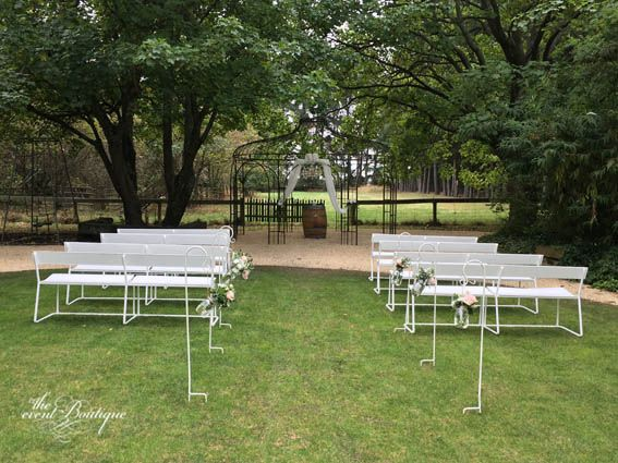 Ceremony setup at Trents Vineyard with our white bench seats, floral and arbour styling.