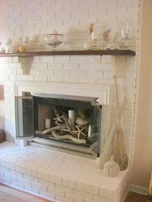 Beach Mantel. Love the driftwood and starfish in the fireplace.
