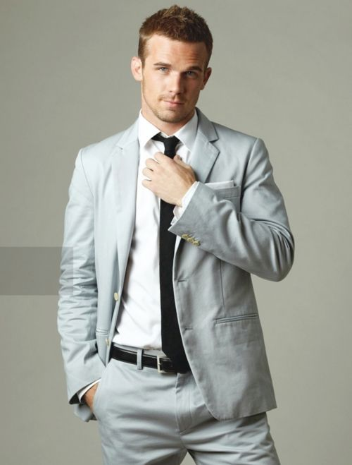 grey suit and skinny tie