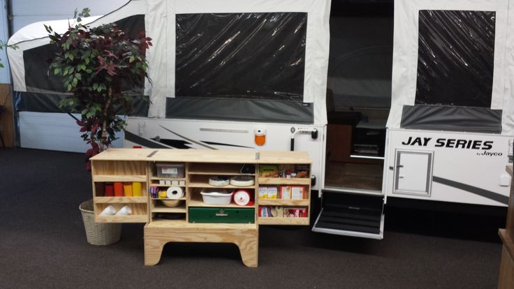 The Camper Kitchen was specifically designed to move in and out of your pop-up camper when the top is closed! The Camper Kitchen sets up in less than a minute and eliminates all of the plastic tables and bins. www.camperkitchen.com