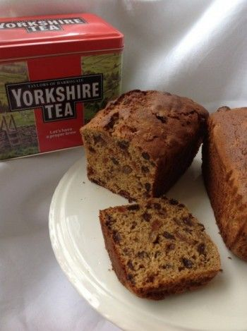 Yorkshire Tea Loaf. A tea loaf is an English cake, made with fruit and cinnamon or other spices, and traditionally served sliced and spread with butter. Tea loaf is now somewhat old-fashioned but is still available, and is particularly associated with Yorkshire. Often in the making of tea loaves, the fruit, usually currants and sultanas, is soaked in cold tea to plump it before mixing it into the batter.