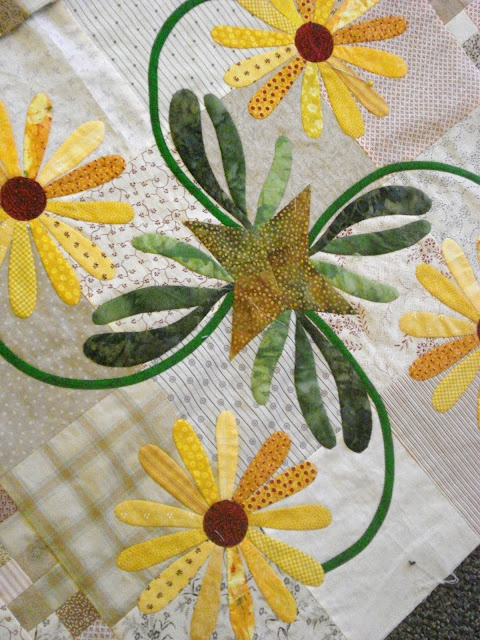 Love the appliqued centres with the leaves - flowers need changed to more of a sunflower shape.  Nice colors!