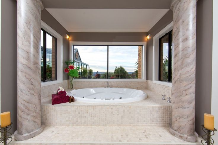 Hand painted marble columns flank the luxurious large oval spa in the main bedroom. This is seriously a fantastic property for sale in NE Victoria Australia.