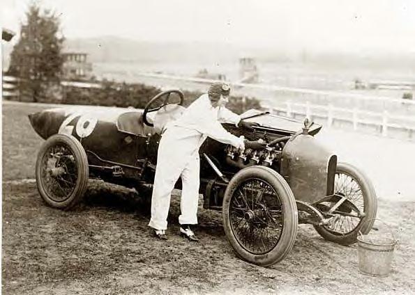 Woman working on Stutz Weightman Special #26 on Benning race track, Washington, DC 1916