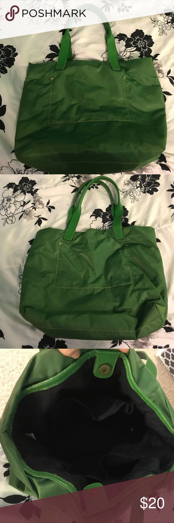 """J Crew green purse Simple J crew purse. Outside is nylon, trim and handles are real leather. Inside is navy with two pockets on the sides, no zippers. Inside is I damaged. Outside, apart from being slouchy, is in excellent condition, it hasn't been used much, handles don't even look like they've been used. 12"""" deep and 16"""" wide. J. Crew Bags Totes"""