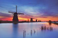 Traditional windmills at sunrise, Kinderdijk, The Netherlands Stock Images