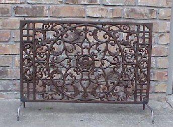 fireplace screen - put legs on iron door mat or clock to use as Fireplace Screen