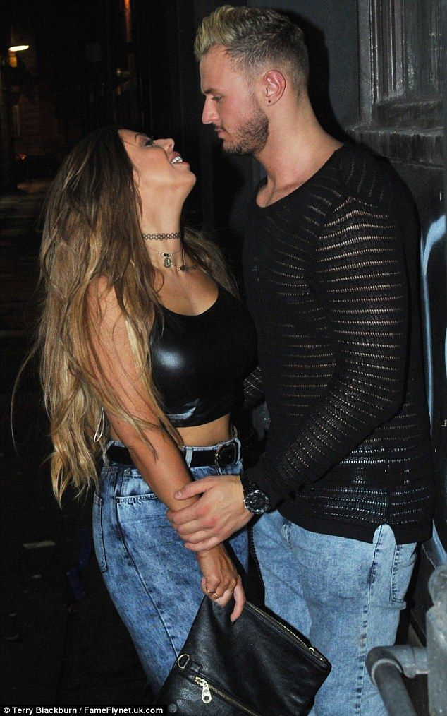 Keeping close: The star was seen looking lovingly at Kyle Christie, who chose a see-throug...