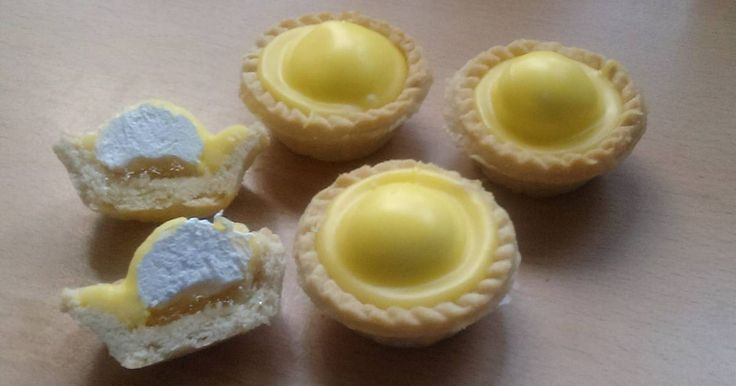 Great recipe for Vickys Scottish Iced Pineapple Cream Tarts. You'll find pineapple, mandarin and strawberry tarts in any family run bakery shop in Scotland. You can use jam in the bases instead of crushed fruit but I find jam a bit too sweet for these combined with the iced tops. A yummy coffee time treat!