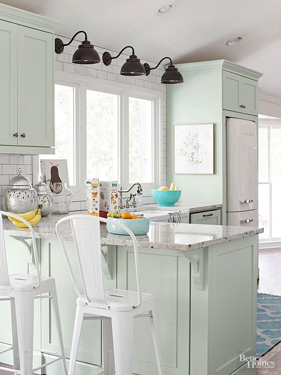 Kitchen Cabinets in Mint Lend a Bright Air of Sophistication to the Space