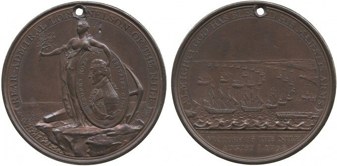 "Nelson's Battle of the Nile medal, copper, showing Peace, standing on a rocky shore with anchor behind, holding an olive branch in her extended right hand and supporting with her left arm an oval medallion with the bust of Lord Nelson and the inscription EUROPE'S HOPE AND BRITAIN'S GLORY. The legend reads, ""REAR-ADMIRAL LORD NELSON OF THE NILE"".  The reverse shows Britain's fleet assembled in Aboukir Bay, with an inscription, 1798."