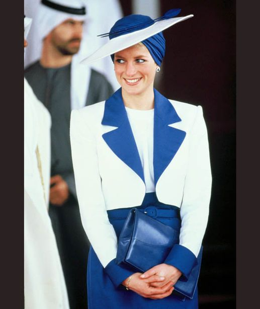 Diana, Princess of Wales, wears a Catherine Walker suit and a Philip Somerville turban hat in Dubai [Getty Images]