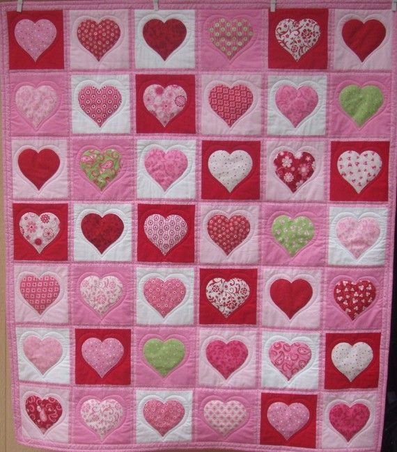 Perfect little girl's heart quilt. Love the quilting and the touches of green!!!